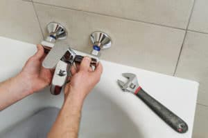Plumber working on tub faucet1